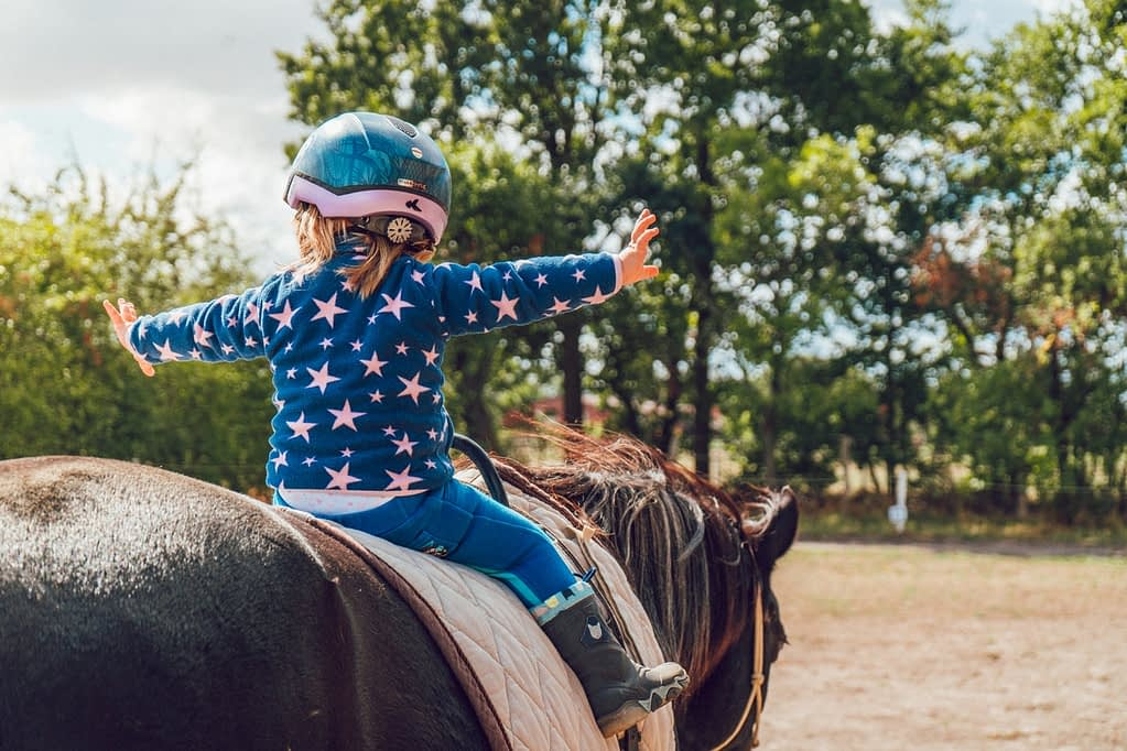 a brave girl on a horse- raising smart kids