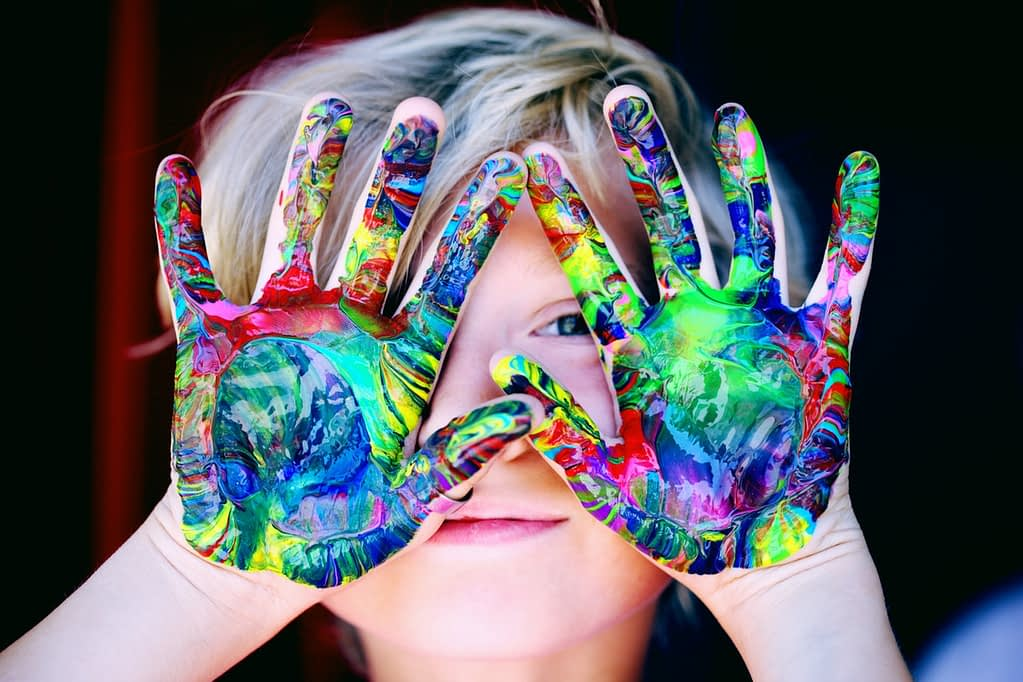 boy with a creative hand paint- raising smart kids