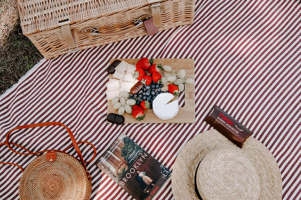 food on picnic table - frugal living tips for moms in 2020