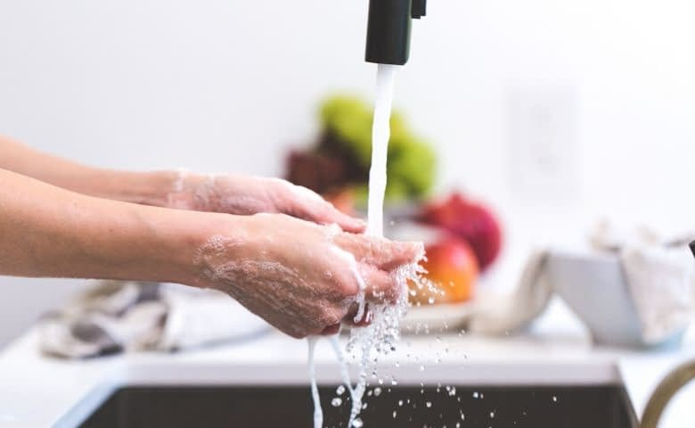woman washing hands- boost your immune system