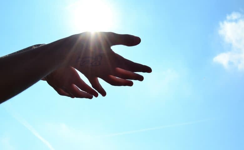hands in sunshine